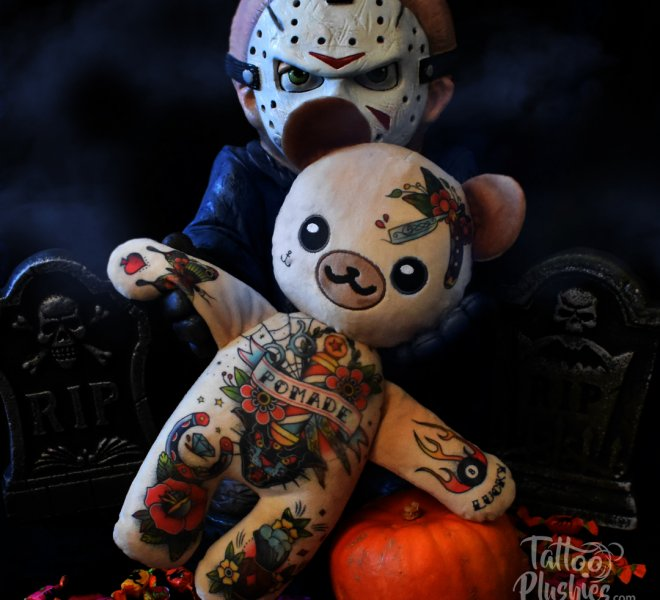 Tattoo Plushie with barber pomade chest piece playing with Jason